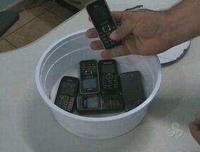 Encontrados celulares em vasilha com feijoada na Casa de Detenção em Guajará-Mirim, RO - Os objetos foram recolhidos e entregues na delegacia de Polícia Civil.