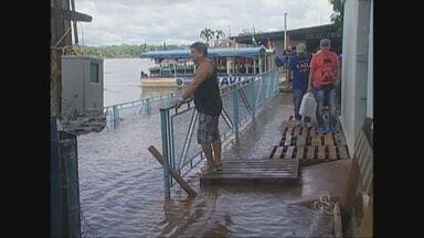 Com a cheia do Rio Mamoré, água invade Porto de Guajará-Mirim, RO - Bilheteria para passageiros que seguem para a Bolívia foi inundada.Posto alfandegário da Receita Federal será montado em novo local.