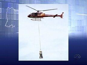 Incêndio atinge edifício em Palhoça e pessoas precisam ser resgatadas de helicóptero - Incêndio atinge edifício em Palhoça e pessoas precisam ser resgatadas de helicóptero