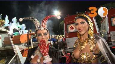 30 segundos: Irmãs Minerato se preparam para desfilar após roubo de parte das fantasias - Tatiana, rainha de bateria da Gaviões da Fiel, e Ana Paula, musa da escola, tiveram acessórios das fantasias e objetos pessoais roubados na madrugada desta sexta-feira (14). Fantasias foram repostas para desfile no Sambódromo.