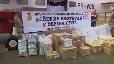 Defesa Civil do AM envia kits de ajuda a vítimas de cheia no AC e seca em RR - Foram enviadas 2,5 toneladas de material de higiene e primeiros socorros.Interior de Roraima, que sofre com seca, receberá 40 caixas d´água.