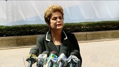 """Dilma admite que reajuste de preços no Brasil são motivo de preocupação - Para ela, 'marolinha' após crise de 2008 virou 'onda': """"Mar não serenou"""", diz. Presidente conversou com jornalistas após encontro de líderes na Bélgica."""