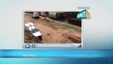 VC no MGTV: Morador reclama de buracos na Rua Macassitas em Juiz de Fora - Rua no Bairro Marilândia está abandonada, segundo o telespectador. Empav informou fará vistoria no local.