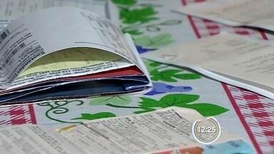 Caderneta é a forma preferida do consumidor que parcela as compras - Os carnês estão de volta.