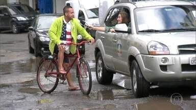 RJ Móvel cobra promessa no Itanhangá, na Zona Oeste do Rio - Moradores pedem obra de saneamento e asfalto na estrada do Itanhangá. Prefeitura prometeu licitação para semestre.