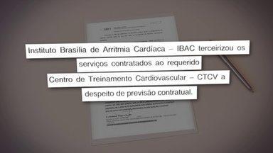 Justiça determina suspensão imediata de licitação no tratamento de pacientes cardíacos - A investigação do Ministério Público de Contas mostra que a Secretaria de Saúde firmou um contrato de quase R$ 8 milhões com a empresa IBAC para realizar exames em pacientes cardíacos. Mas a IBAC usou o dinheiro para contratar outra empresa.