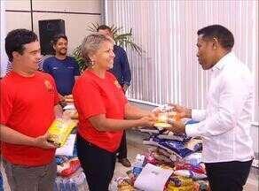 Grupo Jaime Câmara realiza entrega de alimentos arrecadados durante Canto Coral - undefined