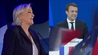 Vencedores do primeiro turno na França já estão em campanha - Segundo turno das eleições presidenciais é em duas semanas. Partidos tradicionais anunciaram apoio ao centrista Emmanuel Macron.