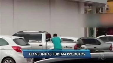 Polícia investiga 'flanelinhas' envolvidos com furtos e roubos no Centro de Macapá - Vídeo mostra um grupo de reparadores pegando produtos de uma picape. PM informou que vai intensificar fiscalização e abordagens.