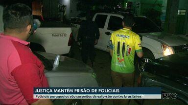 Justiça mantém prisão de policiais - Eles são suspeitos de extorsão contra brasileiros.