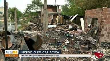 Famílias afetadas por incêndio em Cariacica tentam retomar vida - Incêndio destruiu quatro casas de madeira e atingiu outras duas.