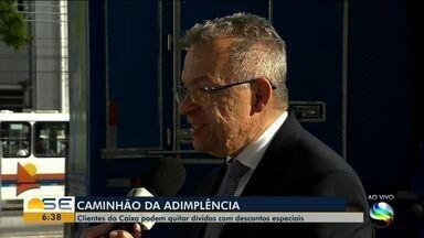 Clientes da Caixa podem quitar dívidas com descontos especiais em Caminhão da Adimplência - Em alguns casos o desconto pode ser de 90%.