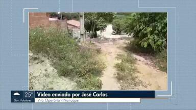VC no MG: Morador do Bairro Vila Operária, reclama de falta de infraestrutura em rua - Morador de Nanuque mostra rua sem asfalto e esburacada.