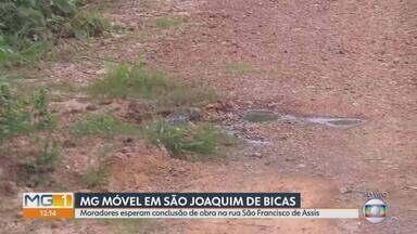 MG Móvel visita bairro Vila Rica, em São Joaquim de Bicas, pela 3ª vez - Moradores ainda aguardam por resolução definitiva dos problemas com falta de asfalto e rede de esgoto na rua São Francisco de Assis, no bairro Vila Rica, em São Joaquim de Bicas.