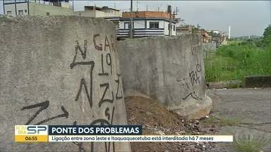 Ponte causa problemas no extremo leste da capital - Principal ligação entre Itaim Paulista, bairro da zona leste, e Itaquaquecetuba, na Grande SP, está interditada há sete meses. Moradores da região sofrem com transtornos e falta de segurança.