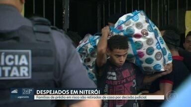 Famílias de prédio em risco são retirados de casa por decisão judicial - Duzentas famílias estão sem teto no centro de Niterói. O edifício não tem luz, água e há risco de vida para os moradores.