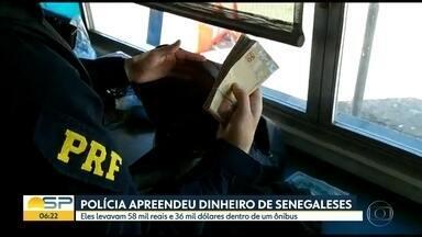 Polícia apreende dinheiro de senegaleses - Eles levavam R$58 mil e US$36 mil dentro de um ônibus e não conseguiram comprovar a origem.