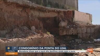 Moradores da Ponta do Leal dizem que maré alta danificou muro do condomínio - Moradores da Ponta do Leal dizem que maré alta danificou muro do condomínio