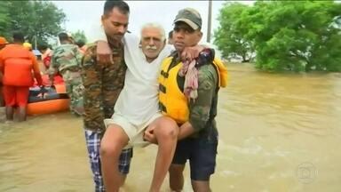 Passa de 140 o número de mortos na Índia por causa da temporada de chuvas - Sul e oeste da Índia são as regiões mais atingidas. Na China, um tufão matou 44 pessoas.