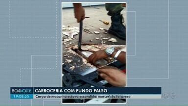 Caminhão com fundo falso é apreendido na PR-445 em Cambé - A polícia encontrou tabletes de maconha escondidos num fundo falso na carroceria.