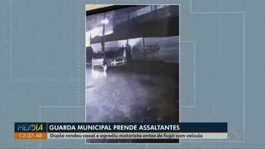 Dupla é presa depois de render casal e roubar carro no centro de Ponta Grossa - Os assaltantes agrediram o motorista antes de conseguir fugir com o carro, eles foram presos pela Guarda Municipal.