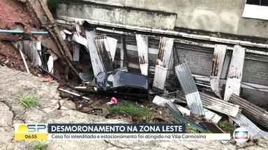 Solo cede e desmoronamento atinge estacionamento na Zona Leste - Casa foi interditada e estacionamento foi atingido na Vila Carmosina.