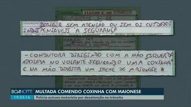 Motorista é multada por comer coxinha com maionese no trânsito - Polícia autuou motorista por desatenção ao volante.