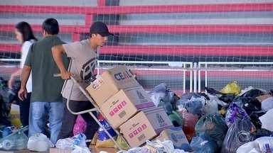 Moradores atingidos pela chuva recebem doações em Araçariguama - Moradores de Araçariguama (SP) fazem um mutirão para arrecadar doações para as famílias atingidas pelas enchentes do Rio Tietê. A ajuda dos voluntários têm trazido conforto para quem perdeu tudo.