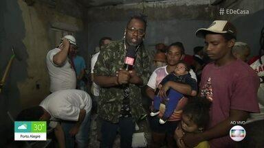 Voluntários ajudam a pintar casa alagada pela chuva em São Paulo - Corrente de solidariedade une pessoas pelo bem do próximo