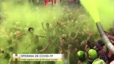 Índia registra mais de 50 casos do novo coronavírus no país - O número de casos na Índia já passa de 50, mais isso não impediu que milhares de pessoas saíssem às ruas para celebrar o tradicional festival das cores.