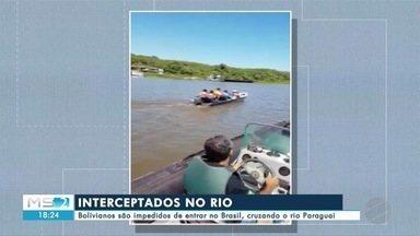 Bolivianos são impedidos de entrar no Brasil, cruzando o rio Paraguai - Bolivianos são impedidos de entrar no Brasil, cruzando o rio Paraguai