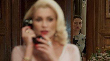 Maria desconfia das intenções de Sandra em relação à busca de Anastácia por Candinho - A empregada escuta a ligação de Sandra para Ernesto