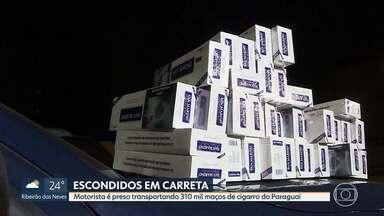 Motorista de carreta é preso transportando 310 mil maços de cigarro contrabandeados - Ele foi abordado durante uma operação na BR-040, em Sete Lagoas.