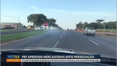 PRF apreende mercadorias após perseguição - Veículo foi abordado, policiais encontraram produtos eletrônicos, mas a motorista tentou fugir.