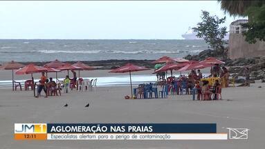 Especialistas alertam para perigo de contaminação por Covid-19 em aglomerações em praias - O uso de máscara é obrigatório nesses locais, entretanto, muitas pessoas acabam desrespeitando a medida.