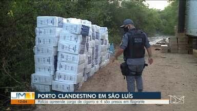 Polícia apreende carga de cigarros contrabandeados em São Luís - A carga estava em uma embarcação em um porto clandestino, na localidade de Batata do Itapera, na zona rural de São Luís.