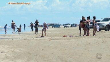 Domingo de sol e feriado de Finados gera movimento nas praias da Região Sul do RS - Assista ao vídeo.