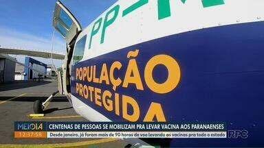Entrega de vacina mobiliza centenas de pessoas no Paraná - Desde janeiro, já foram mais de 90 horas de voo levando vacinas pra todo estado