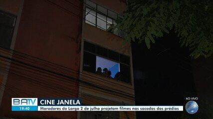 Iniciativa projeta filmes em fachada de prédio para entreter população em isolamento