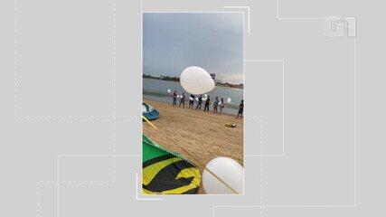 Amigos de homem morto em condomínio de luxo em Salvador realizam homenagem e soltam balões