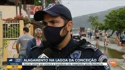 Alagamento na Lagoa da Conceição: Carros caem em cratera e moradores são resgatados