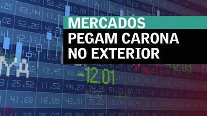 Mercados pegam carona no exterior e fecham em alta