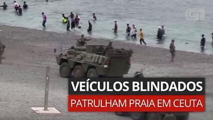 VÍDEO: blindados patrulham praia enquanto milhares de imigrantes chegam em Ceuta