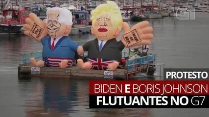 Video: i manifestanti protestano con Biden e Boris Johnson al G7 مجموعة