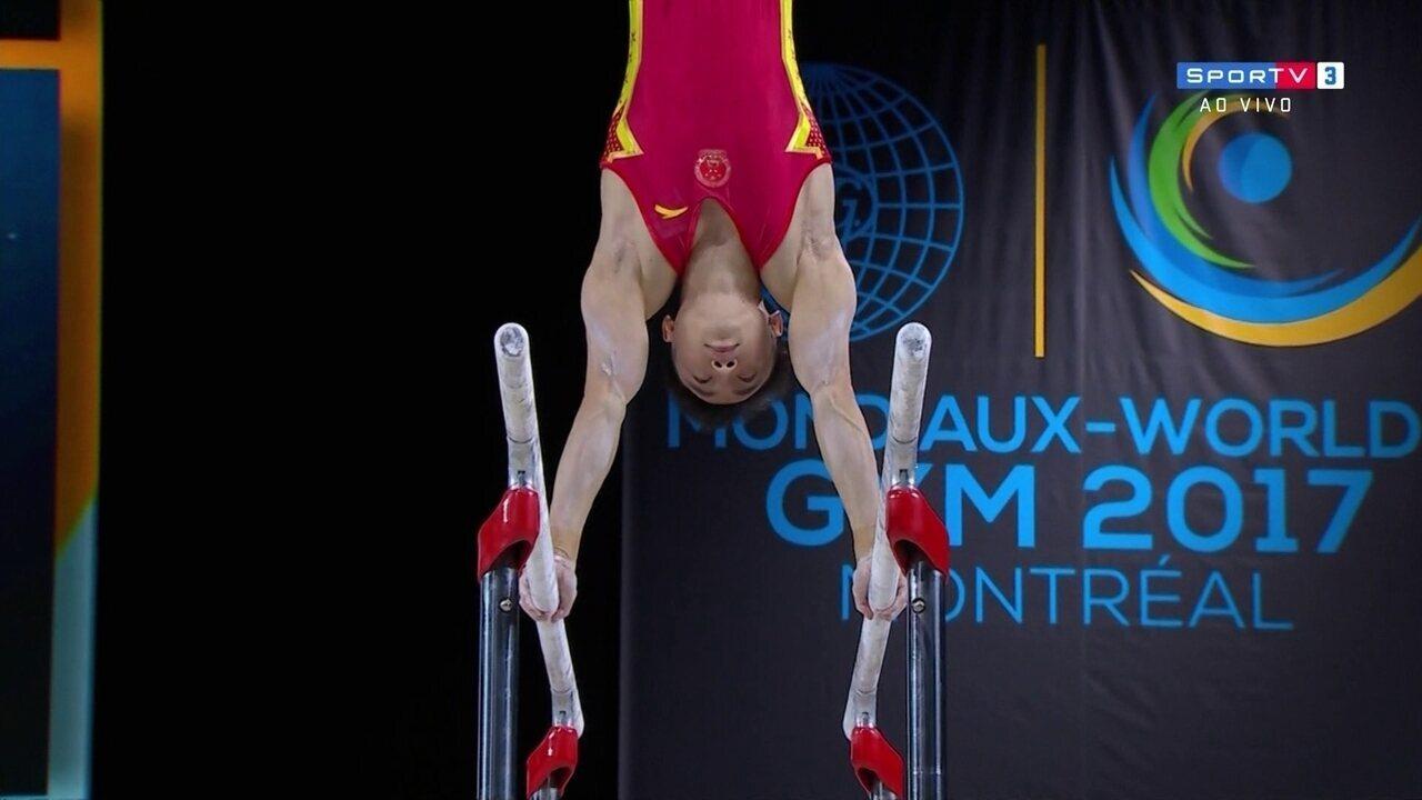 Zou Jingyuan tira 15.900 em sua apresentação nas barras paralelas