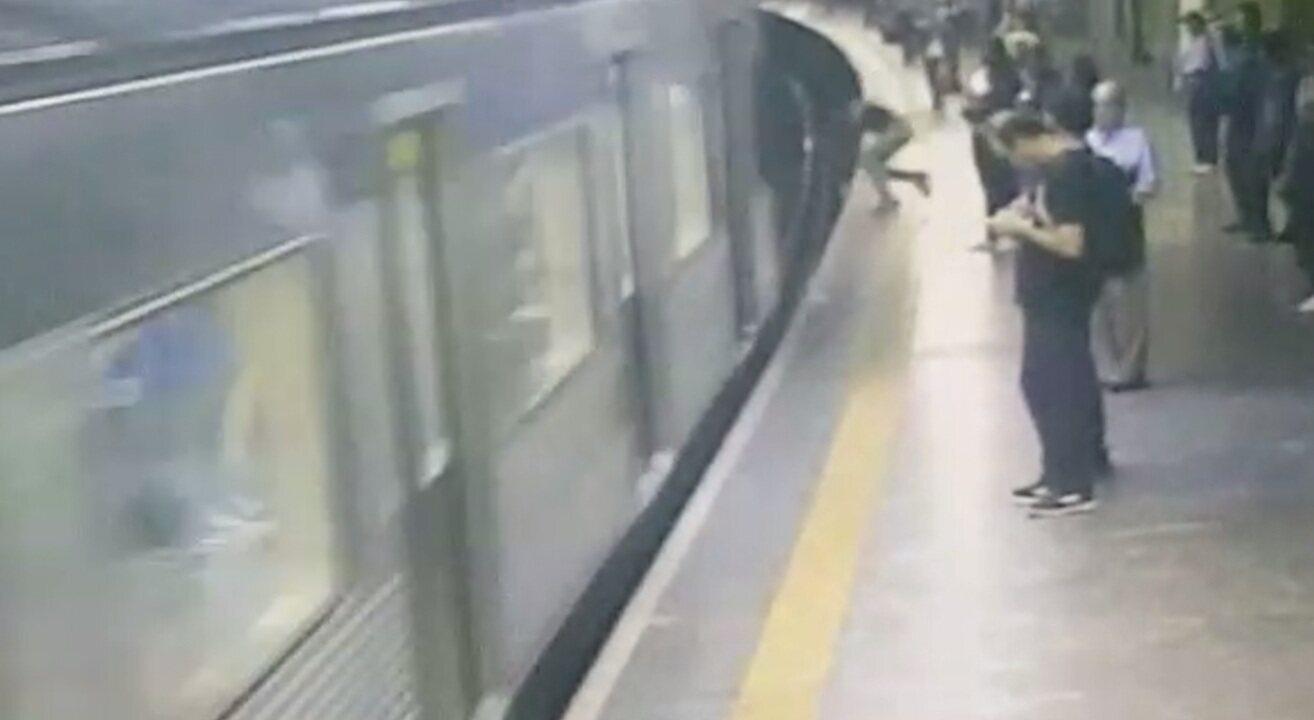 Mulher sobrevive após ser jogada na frente de trem em SP