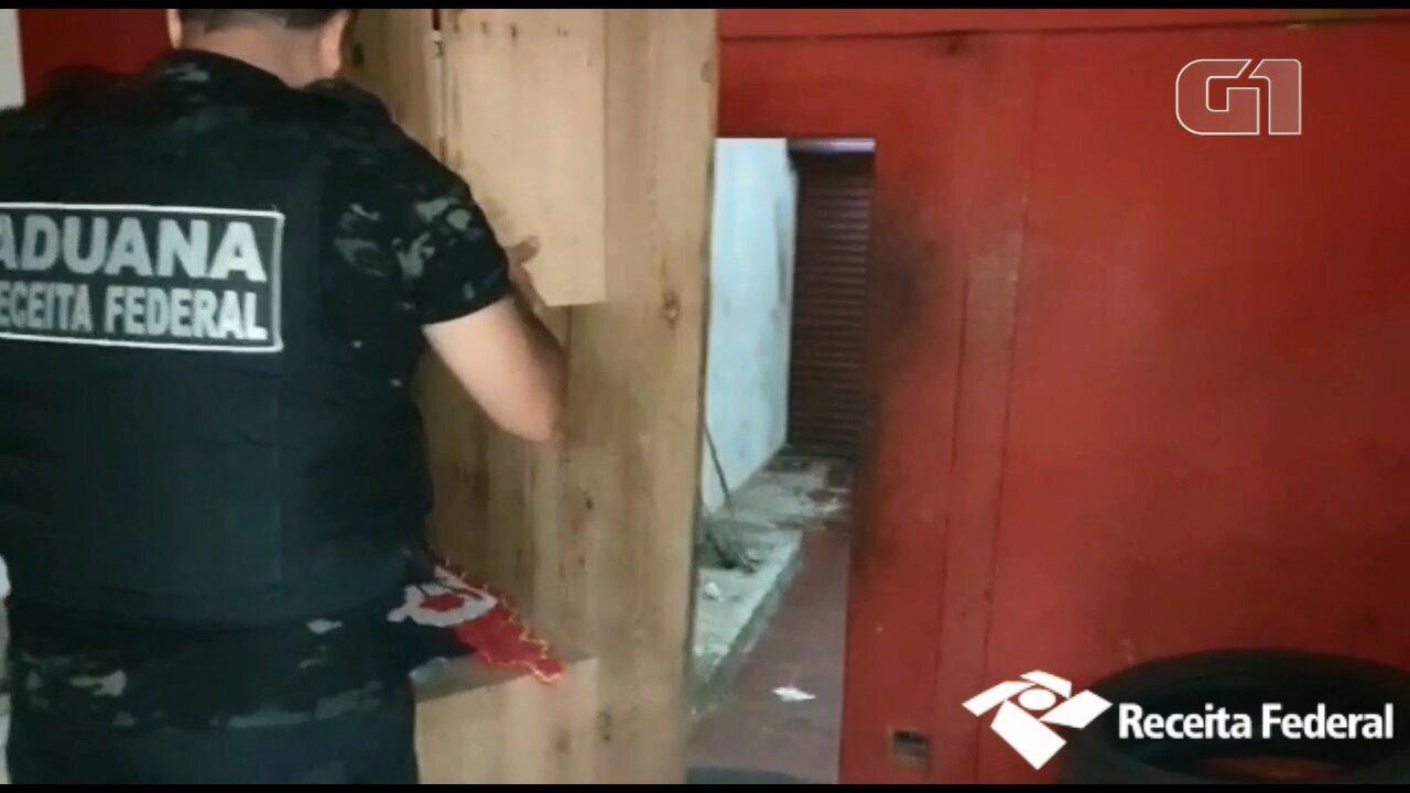 Receita descobre passagem secreta em borracharia para esconder contrabando