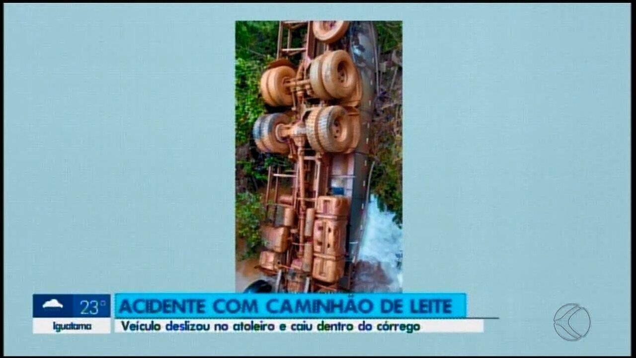 Caminhão carregado de leite desliza ribanceira e cabine fica submersa em córrego em Tapira